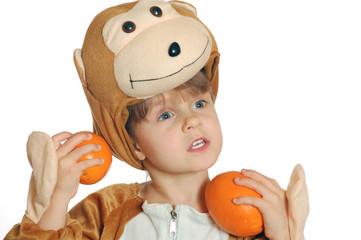 monkey girl with oranges