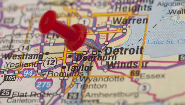red push pin pointing on detroit