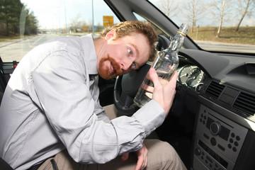 Drunk man sitting in drivers