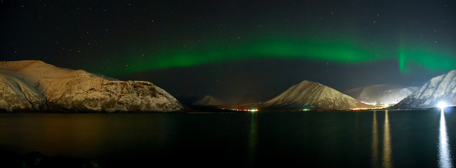 Panorama of Aurora polaris above  a lake