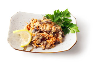 Mix from soused mushrooms and carrot with parsley and lemon