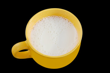 Fresh milk in big cup on black background with clipping path.