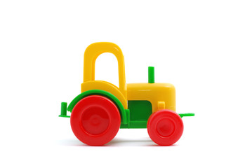 Small toy tractor isolated on white
