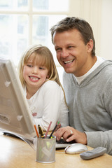 Father And Daughter Using Computer
