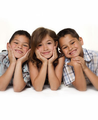 Adorable group shot of two boys and on little girl