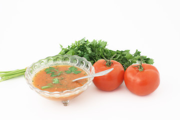 A soup with tomatoes and parsley