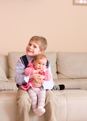 Brother holding little sister
