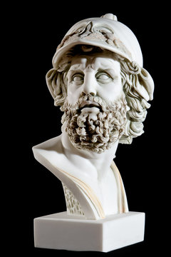 Classical painted marble Zeus Bust isolated on black