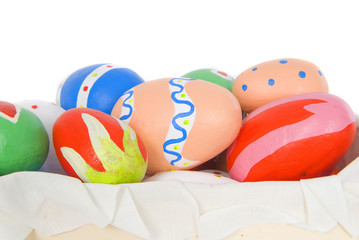 child colored easter eggs in a box