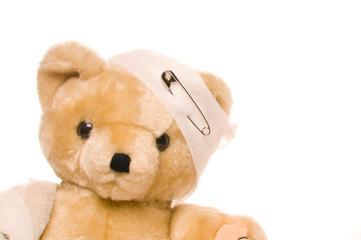 Teddy bear with bandage