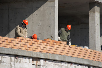Builders at the construction site