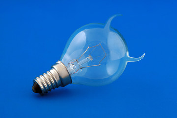 Electrical lamp on blue background