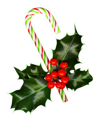 Clipping path. Candy cane, holly leaves and berries on white