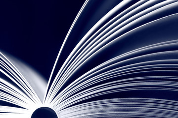 Open book on dark background