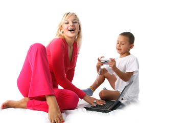 young lovely mom and son with pc and digital photo camera