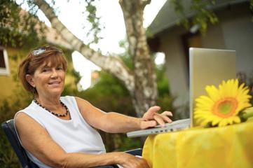 Senior women with laptop