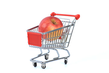 Apple in shopping basket isolated