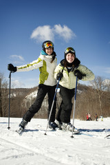 Two young girls skiing together
