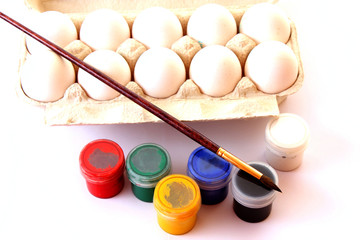 eggs, paints and brush