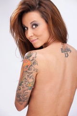 Tattos on woman's hand and back
