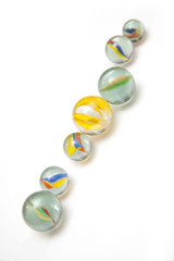 Glass marbles isolated on a white studio background.