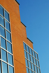 brick and glass architecture against blue sky