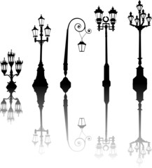 five street lamps with reflections