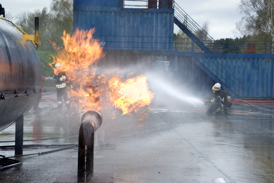 Firefighters extinguishing pipeline fire