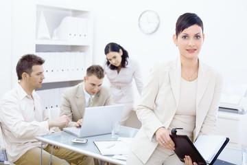 Businesswoman holding organizer