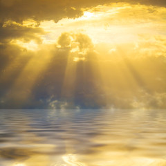 Sunset sun rays through clouds