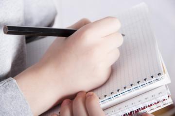 Hand writing something