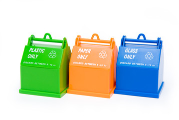 Three recycle bins in green, orange and blue