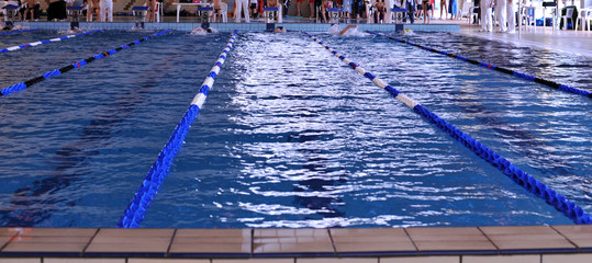 A new lap for teens during playoff in a indoor swimming pool