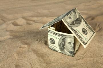 Dollar house on sand.