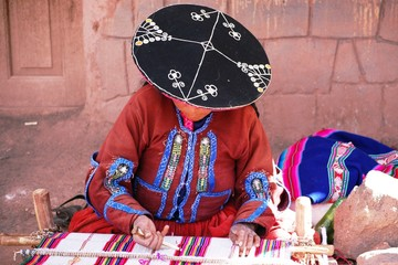 Woman weaver at Raqchi, Peru