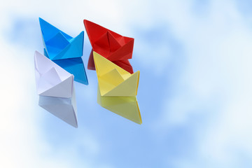 Paper Boats On Blue Sky Background