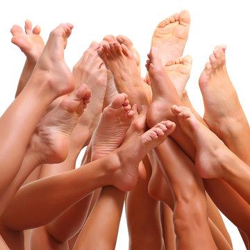 Beautiful female slim feet of group of girls