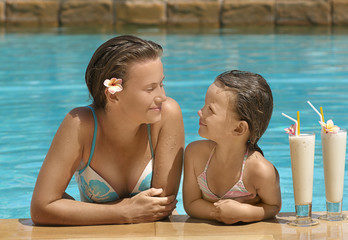 woman and girl in the swimming pool
