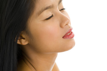 young asian woman with eyes closed