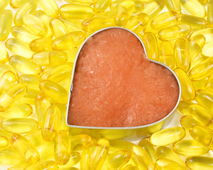 silver outlined salmon heart surrounded by salmon oil