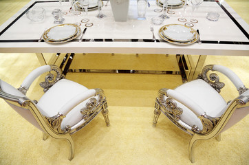 served table and two chairs