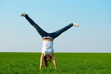 young woman doing cartwheel
