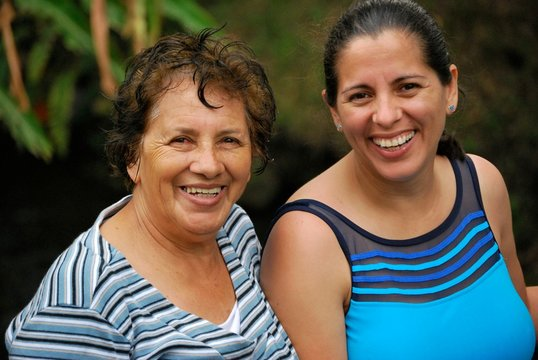 Hispanic mother and middle aged daughter
