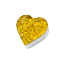 silver heart filled with salmon oil