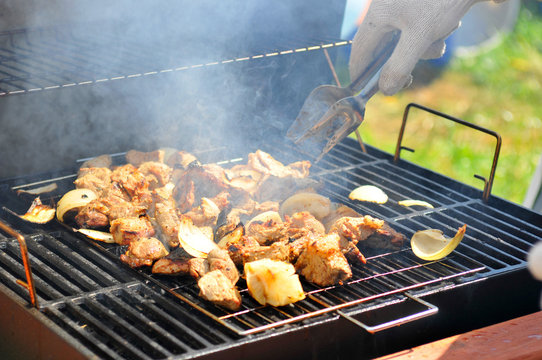 potato cooking on barbecue grill