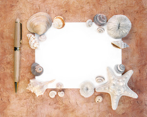 Sea Shells with Note Paper and Pen