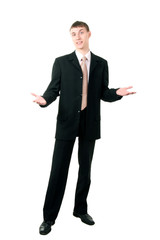 young businessman shrugging, isolated on white