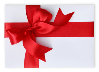 Present with red bow isolated on white background