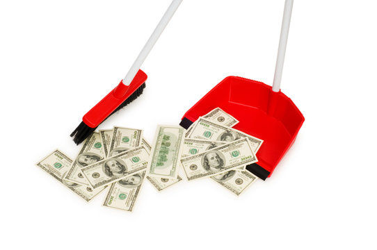 Brush sweeping dollars isolated on the white