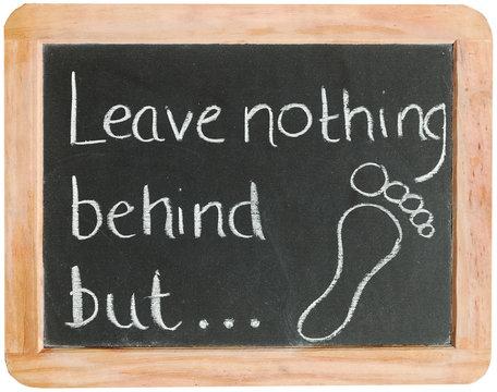 """Leave nothing behind but ..."" on blackboard"